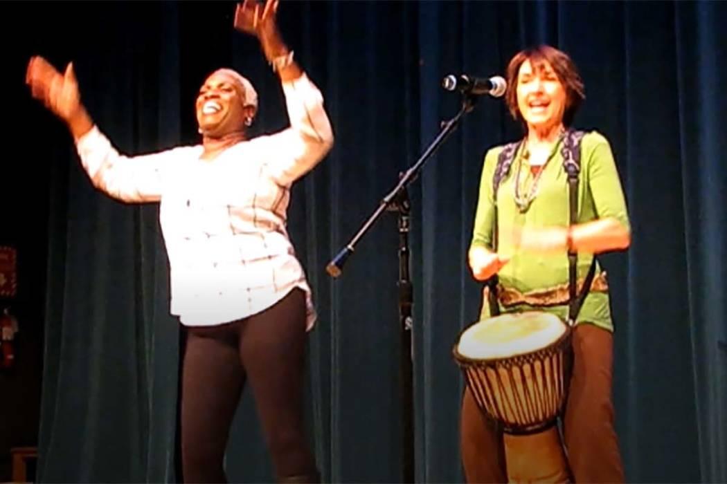 "Rochelle Hooks and Karla Huntsman performing a Nigerian welcome song called, ""Funga Alafia."" (Brett Hendricks)"
