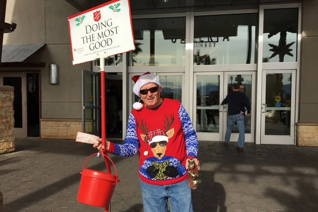 Laird Noble Sanders rings Salvation Army bells at the Galleria at Sunset mall. (Courtesy, Rhonda Sanders)