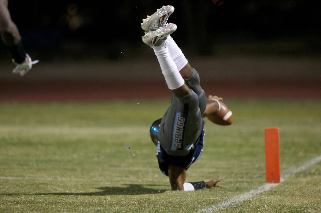 Canyon Springs' Xavier Delong scores a touchdown against Green Valley High School in the second half of a football game at Canyon Springs High School in North Las Vegas, Friday, Sept. 7, 2018. Chi ...