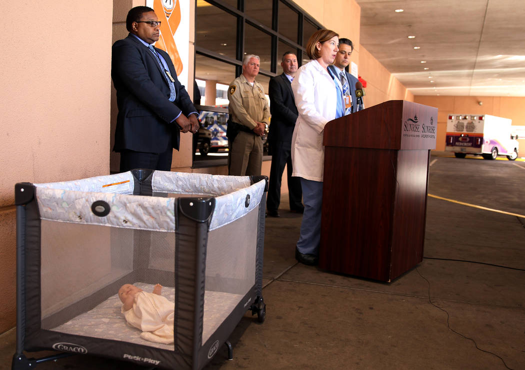 Dr. Kelly Kogut, medical director of children's surgery at Sunrise Children's Hospital, talks about proper sleeping technique for babies during a news conference at Sunrise Children's Hospital Thu ...