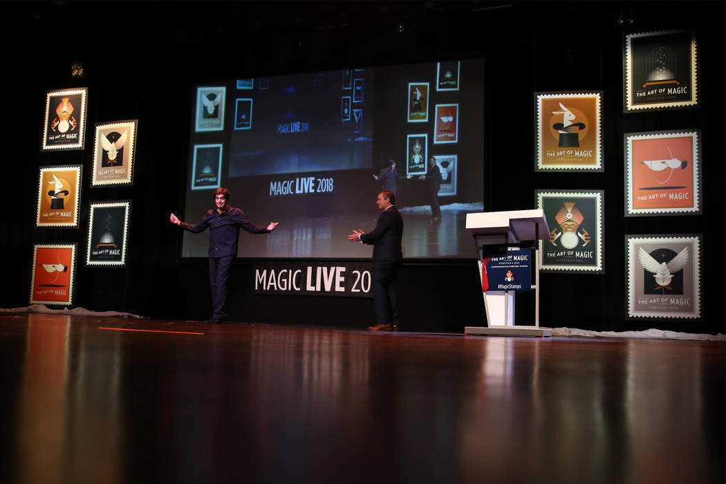 Magician David Copperfield, left, with Jeffrey Williamson, chief human resources officer and executive vice president for the United States Postal Service, unveil new magic themed stamps during th ...
