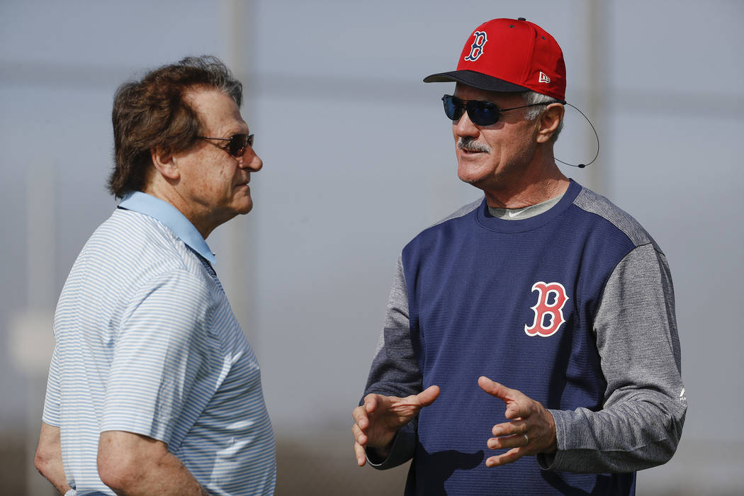 Boston Red Sox special assistant Tony La Russa, left, and player development consultant Dwight Evans, right, speak during baseball spring training, Tuesday, Feb. 13, 2018, in Fort Myers, Fla. (AP ...