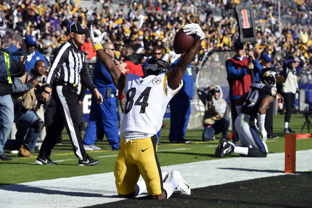 Pittsburgh Steelers wide receiver Antonio Brown celebrates after scoring a touchdown in the first half of an NFL football game against the Baltimore Ravens, Sunday, Nov. 4, 2018, in Baltimore. (AP ...