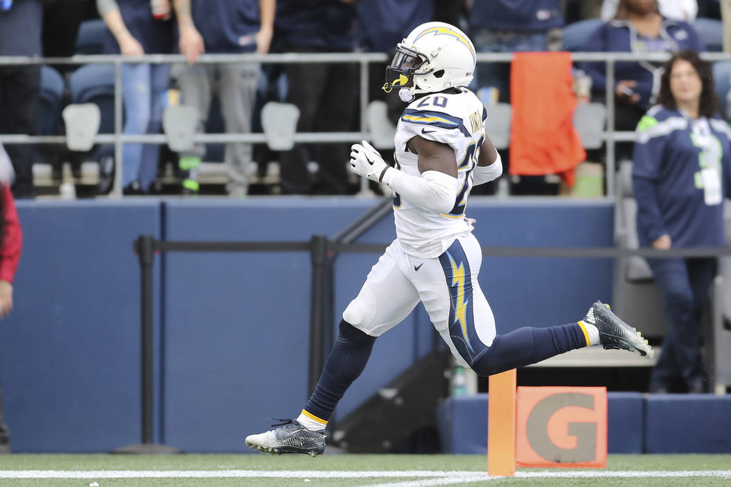 Los Angeles Chargers defensive back Desmond King (20) crosses the goalie with a pick six in the second half of an NFL football game, Sunday, Oct. 28, 2018, in Los Angeles. (AP Photo/Peter Joneleit)