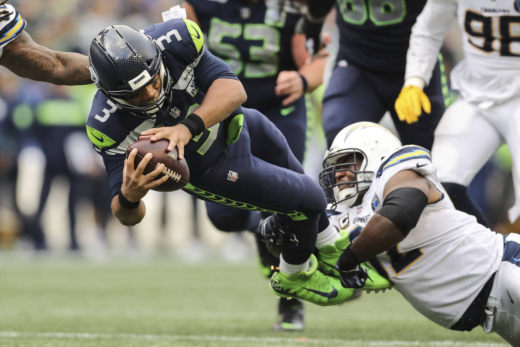 Seattle Seahawks quarterback Russell Wilson (3) dives for extra yardage in the second half of an NFL football game, Sunday, Oct. 28, 2018, in Los Angeles. (AP Photo/Peter Joneleit)