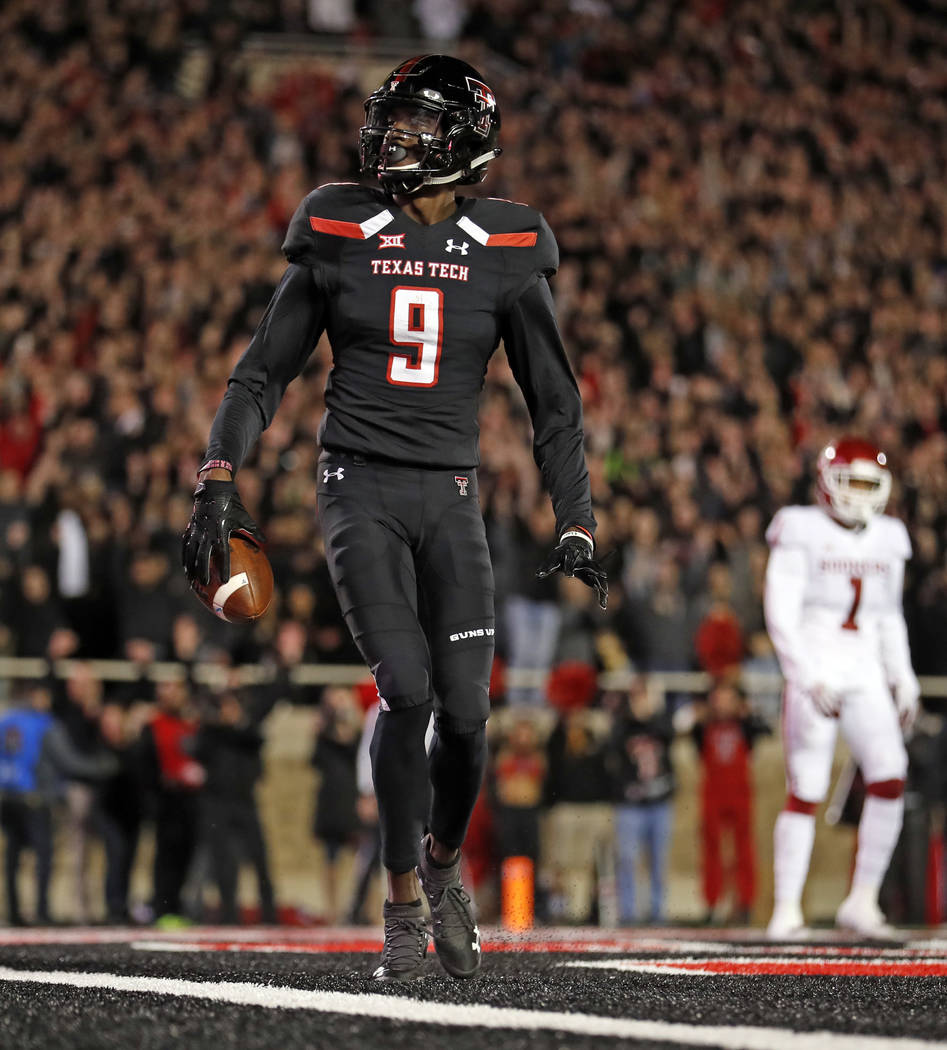 Texas Tech's T.J. Vasher (9) celebrates after scoring a touchdown during the first half of an NCAA college football game against Oklahoma, Saturday, Nov. 3, 2018, in Lubbock, Texas. (AP Photo/Brad ...