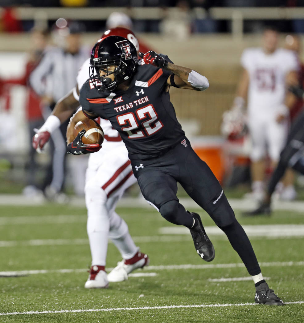 Texas Tech's Seth Collins (22) runs down field with the ball during the first half of an NCAA college football game against Oklahoma, Saturday, Nov. 3, 2018, in Lubbock, Texas. (AP Photo/Brad Toll ...