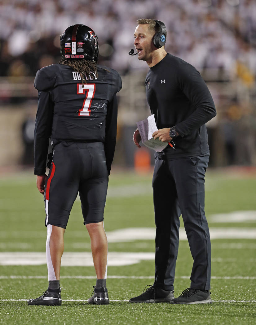 Texas Tech coach Kliff Kingsbury talks to quarterback Jett Duffey (7) during a timeout in the second half of an NCAA college football game against Oklahoma, Saturday, Nov. 3, 2018, in Lubbock, Tex ...