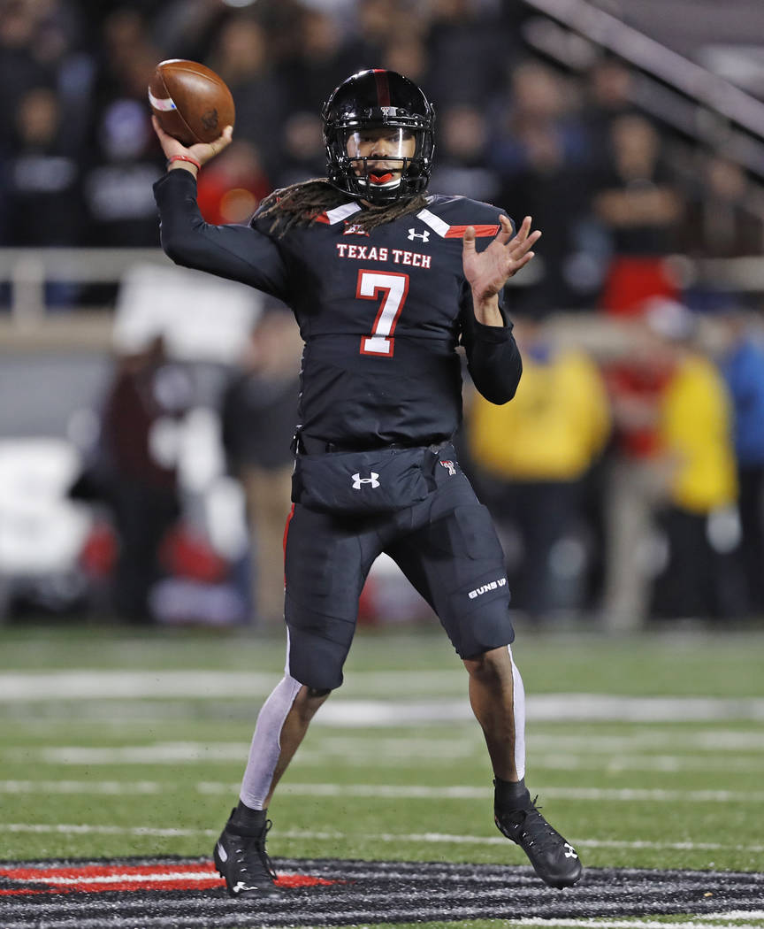 Texas Tech's Jett Duffey throws a pass during the second half of the team's NCAA college football game against Oklahoma, Saturday, Nov. 3, 2018, in Lubbock, Texas. (AP Photo/Brad Tollefson)