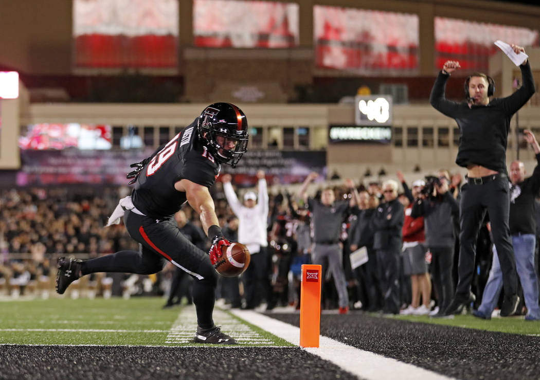 Texas Tech's Zach Austin (19) scores a touchdown during the second half of the team's NCAA college football game against Oklahoma, Saturday, Nov. 3, 2018, in Lubbock, Texas. Texas Tech coach Kliff ...
