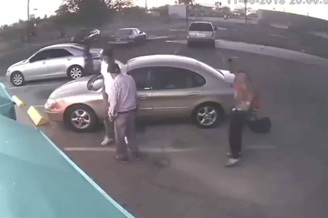 In an image taken from video, three males approach an elderly man in the 2500 block of Fremont Street on Tuesday, Nov. 6, 2018, beating him and stealing his car and other items. (Las Vegas Metropo ...