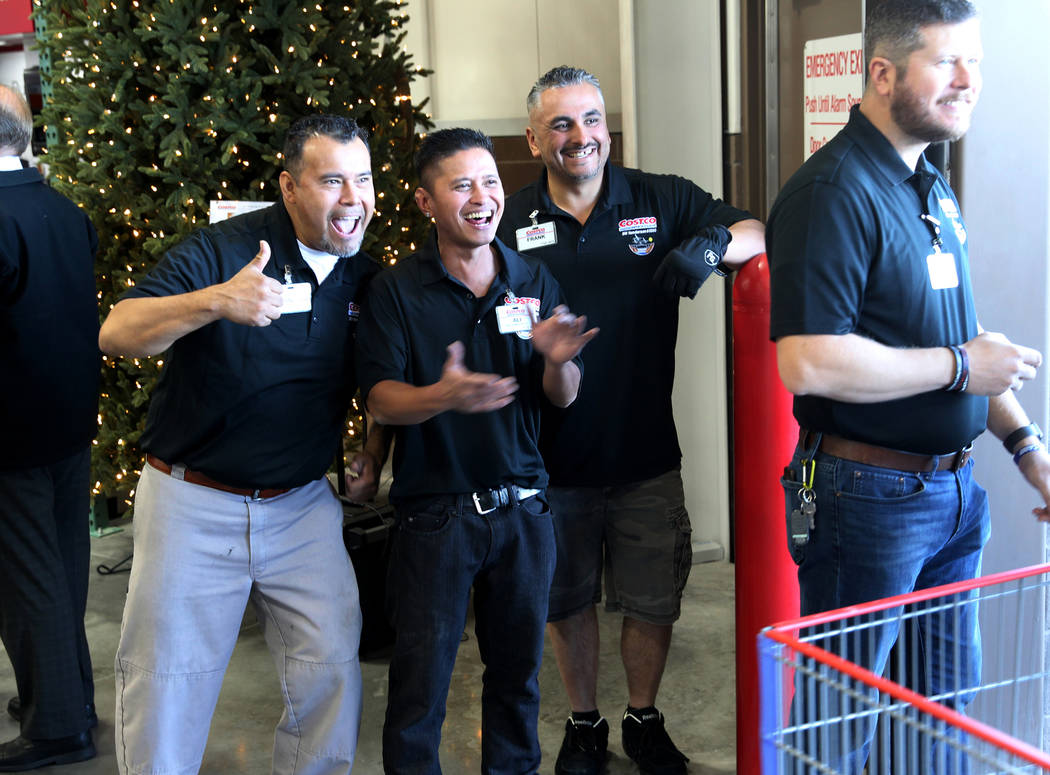 Workers, from left, Francisco Lorenzo, Ali Padilla, Frank Valdez and Bradley Balfour welcome the first customers at the grand opening of Costco near the intersection of St. Rose Parkway and Amigo ...