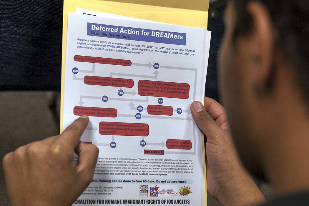 A legal immigrant reads a guide of the conditions needed to apply for Obama-era Deferred Action for Childhood Arrivals (DACA) program at the Coalition for Humane Immigrant Rights, CHIRLA offices i ...