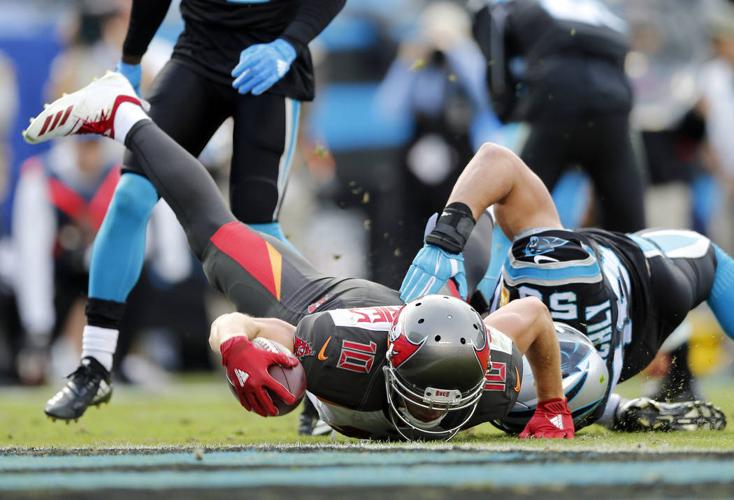 Tampa Bay Buccaneers' Adam Humphries (10) dives for a touchdown against Carolina Panthers' Luke Kuechly (59) in the second half of an NFL football game in Charlotte, N.C., Sunday, Nov. 4, 2018. (A ...