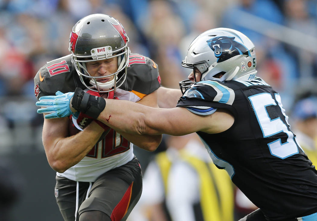 Carolina Panthers' Curtis Samuel (10) is tackled by Carolina Panthers' Luke Kuechly (59) in the second half of an NFL football game in Charlotte, N.C., Sunday, Nov. 4, 2018. (AP Photo/Nell Redmond)