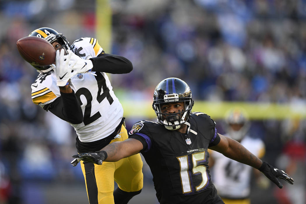 Pittsburgh Steelers cornerback Coty Sensabaugh, left, breaks up a pass-attempt to Baltimore Ravens wide receiver Michael Crabtree in the second half of an NFL football game, Sunday, Nov. 4, 2018, ...