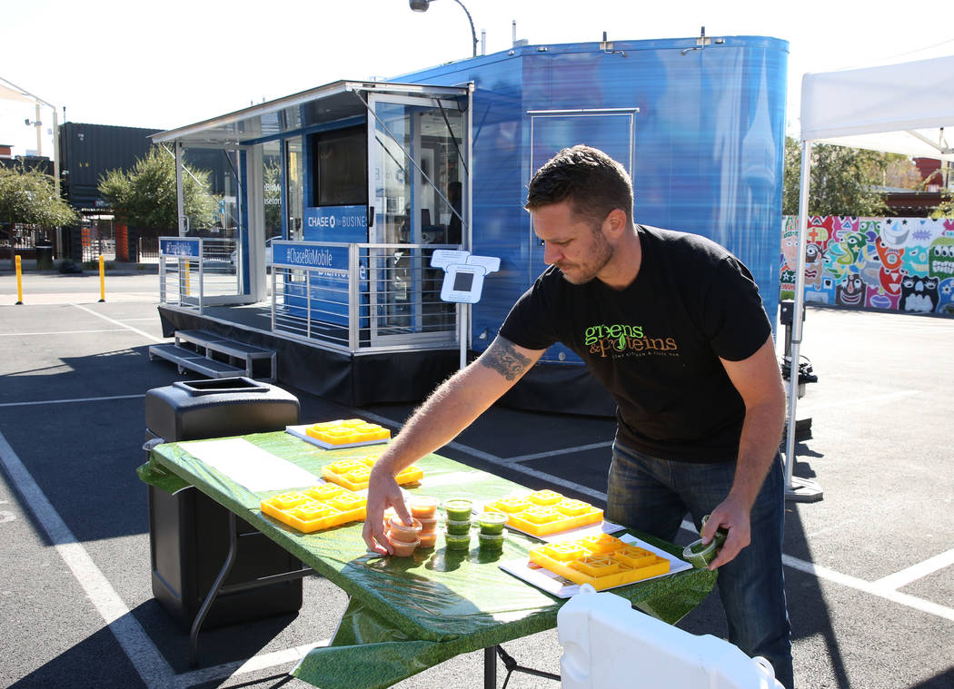 Patrick Haggerty, co-founder of Greens and Proteins, displays protein drinks outside the Chase for Business BizMobile, a 27-foot advice center on wheels, on Thursday, Nov. 8, 2018, in Las Vegas. B ...
