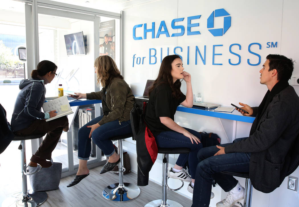 Brooklynne Peters, second left, creative director at Zen Media and Melanie Majors, community coordinator, second right, discuss with Irene Chiu, left, founder of small businesses, and Chase Spillm ...
