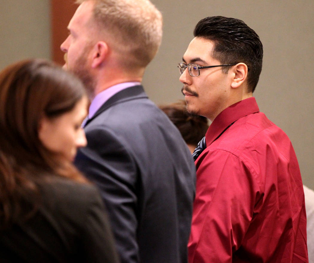 Casey Sandoval, who fatally shot his girlfriend, Ariele Azrate-Lujan, in 2015, stands with his attorney Robert O'Brien as the jury walks into the courtroom for closing arguments in his murder tria ...