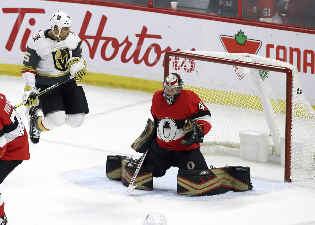 The puck gets past Ottawa Senators goaltender Craig Anderson (41) as he is screened by Vegas Golden Knights right wing Ryan Reaves (75) on a shot by Vegas Golden Knights defenseman Shea Theodore, ...