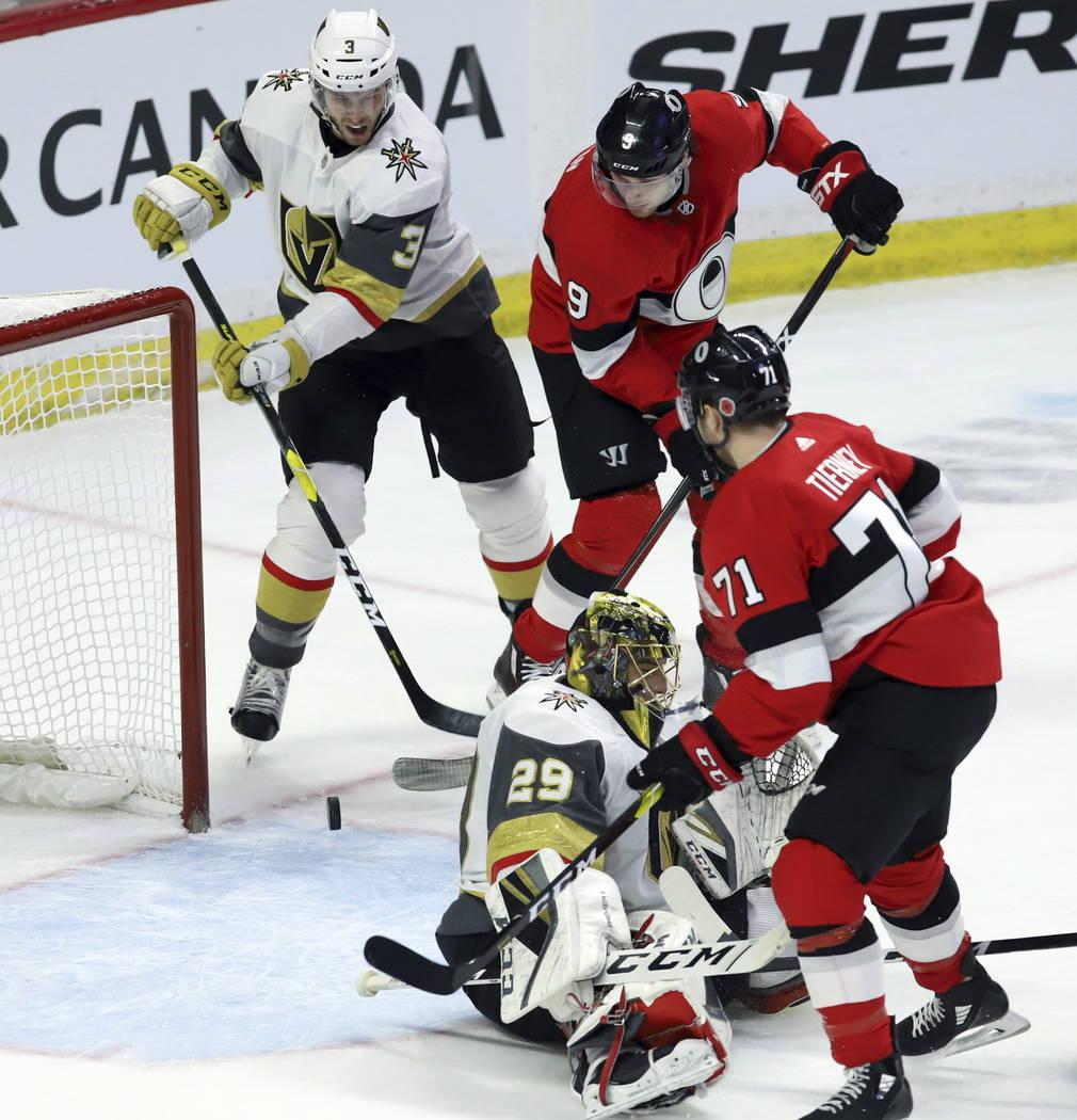 Ottawa Senators right wing Bobby Ryan (9) attempts to tip the puck pass Vegas Golden Knights goaltender Marc-Andre Fleury (29) as Vegas Golden Knights defenseman Brayden McNabb (3) defends and Ott ...