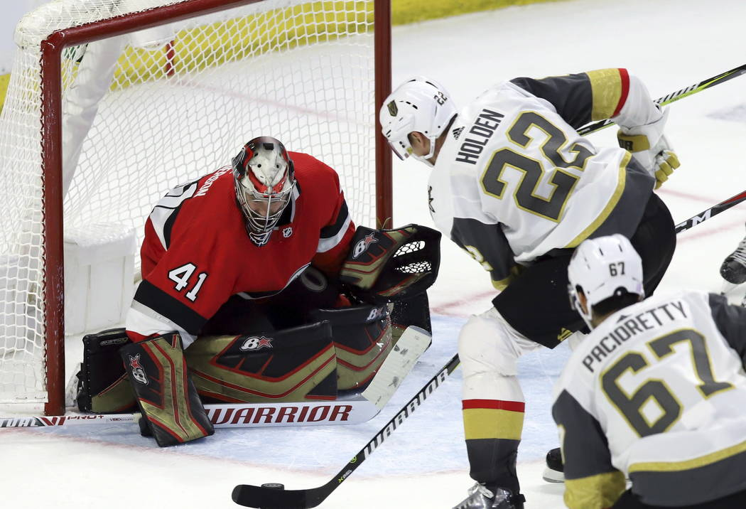 Vegas Golden Knights defenseman Nick Holden (22) scores on Ottawa Senators goaltender Craig Anderson (41) as Vegas Golden Knights left wing Max Pacioretty (67) looks on during the second period of ...