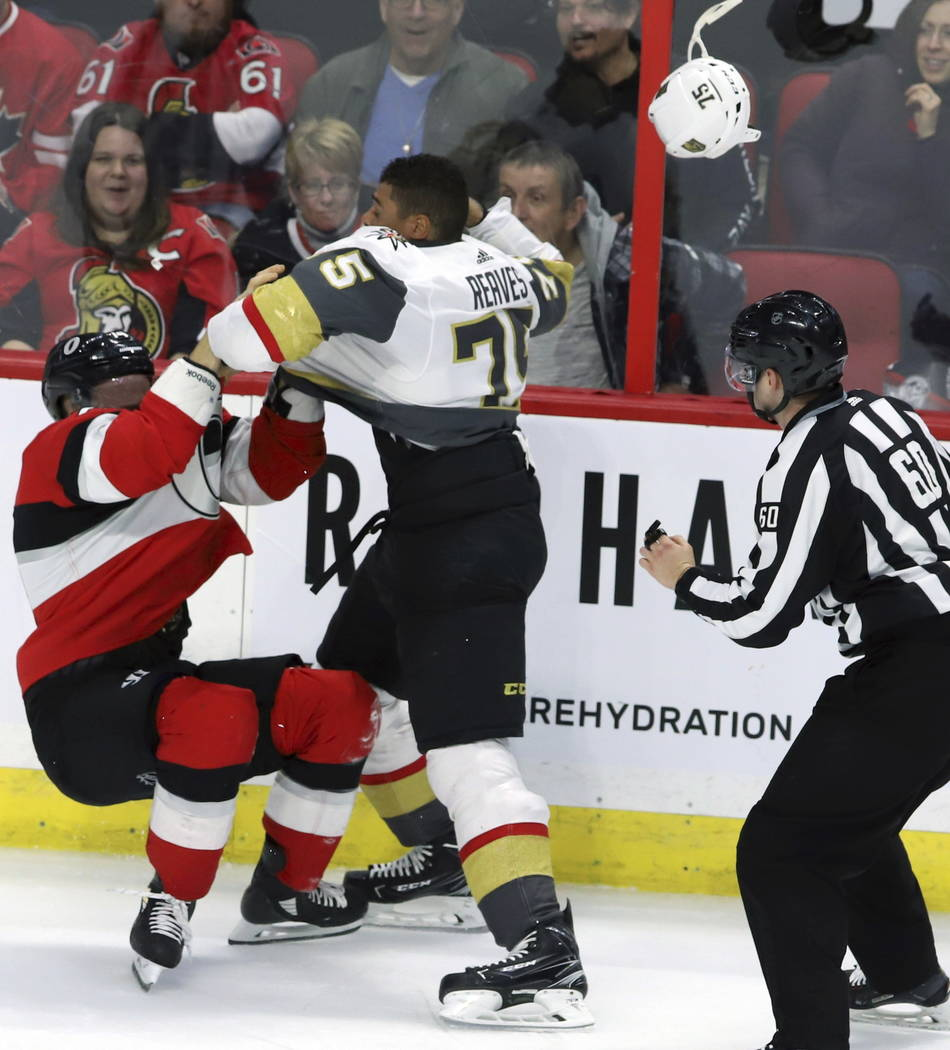 Ottawa Senators defenseman Mark Borowiecki (74) and Vegas Golden Knights right wing Ryan Reaves (75) fight during the second period of an NHL hockey game, Wednesday, Nov. 8, 2018 in Ottawa, Ontari ...