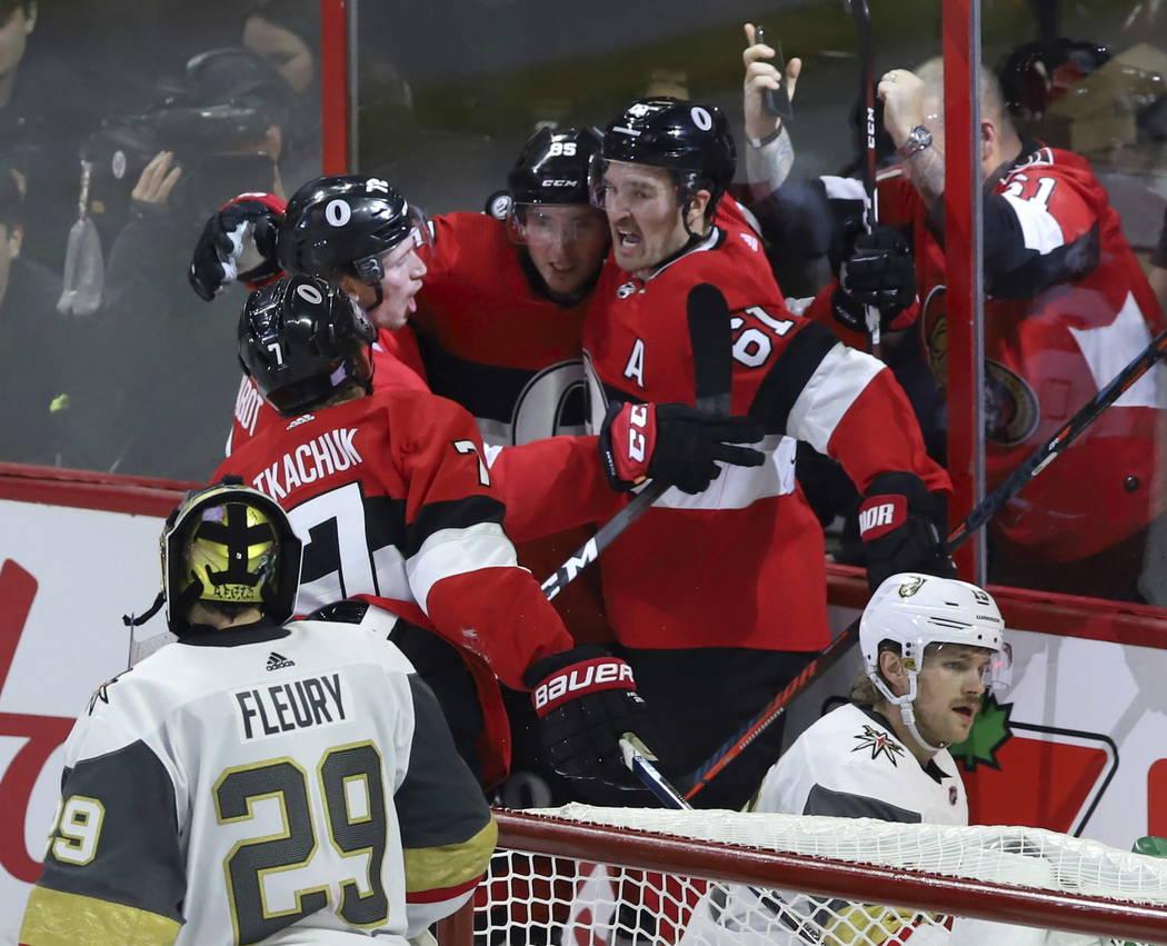 Ottawa Senators center Matt Duchene (95) celebrates his goal against the Vegas Golden Knights with teammates Mark Stone (61) Thomas Chabot and Brady Tkachuk (7) as Vegas Golden Knights goaltender ...