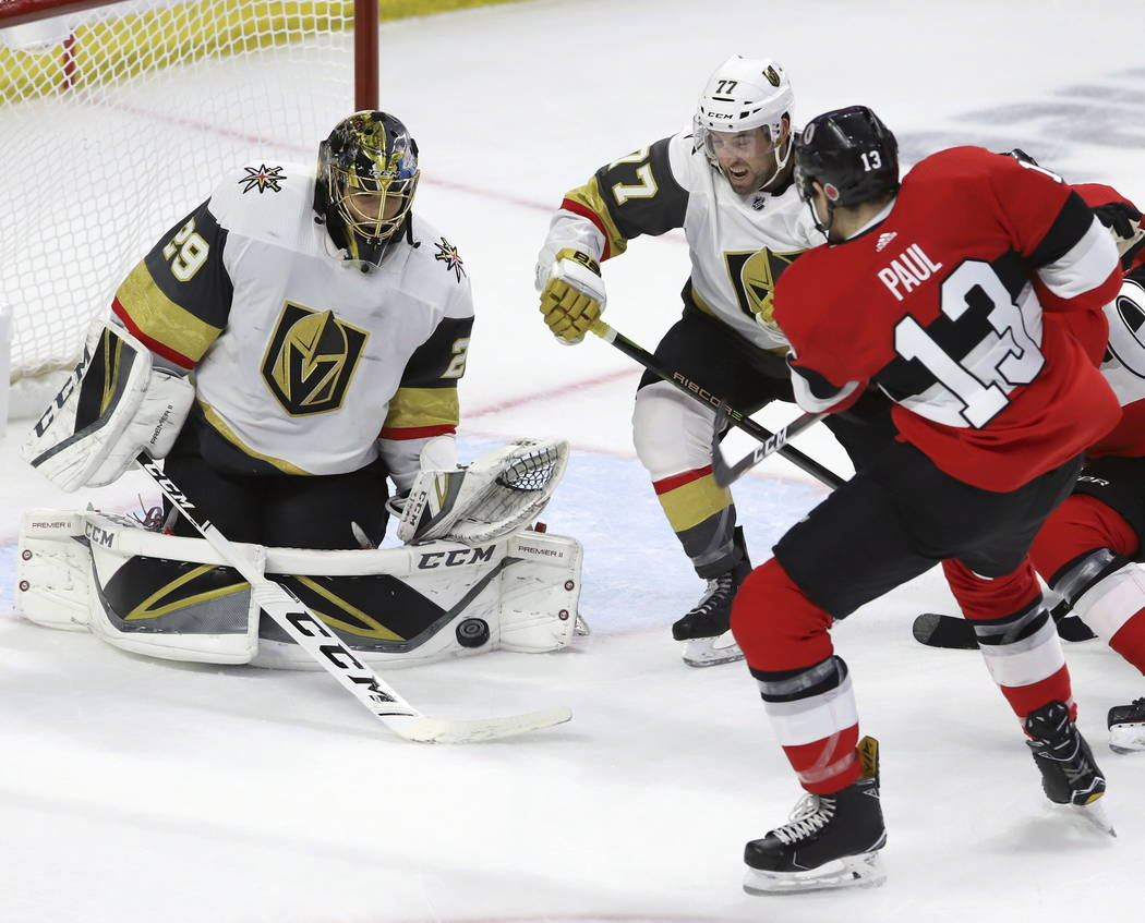 Vegas Golden Knights goaltender Marc-Andre Fleury (29) makes a pad save on Ottawa Senators left wing Nick Paul (13) as Vegas Golden Knights defenseman Brad Hunt (77) defends during the third perio ...