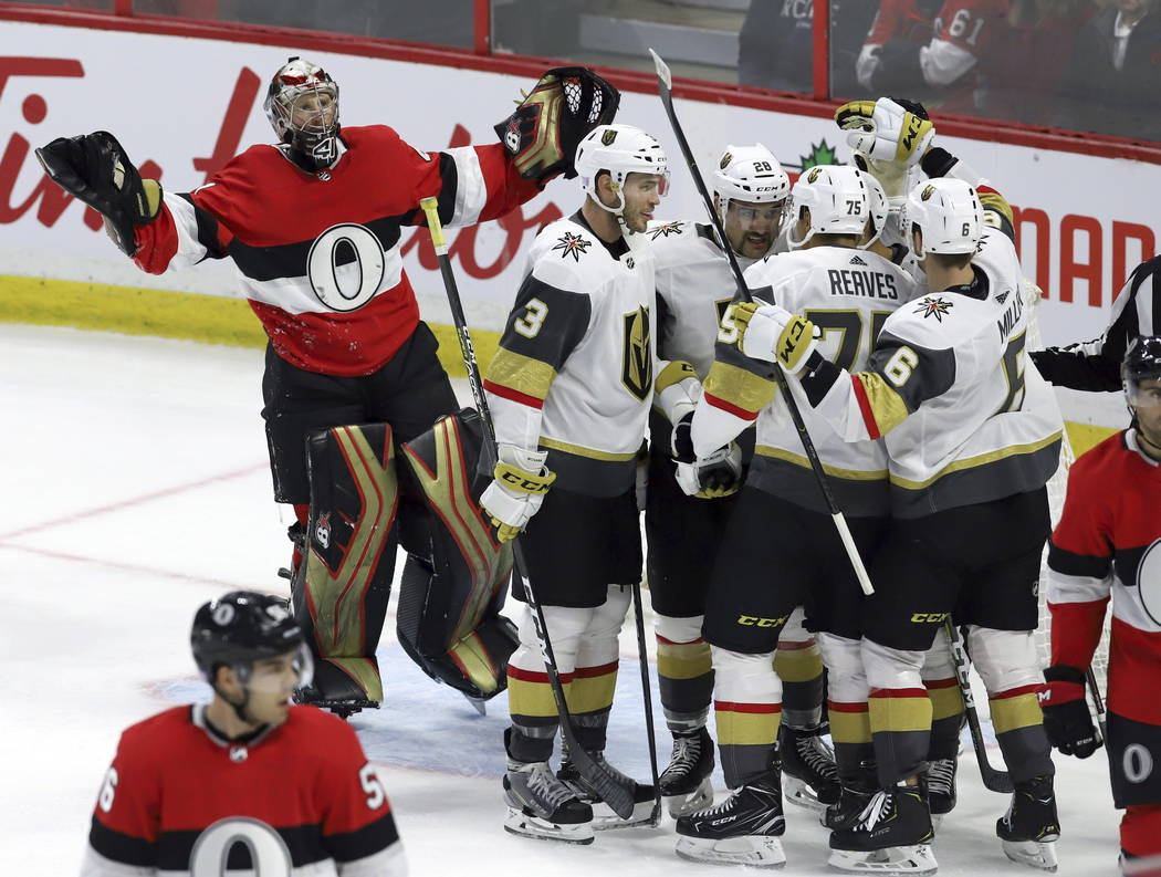 Ottawa Senators goaltender Craig Anderson (41) reacts as he claims goaltender interference after Vegas Golden Knights center Pierre-Edouard Bellemare (41) during the third period of an NHL hockey ...