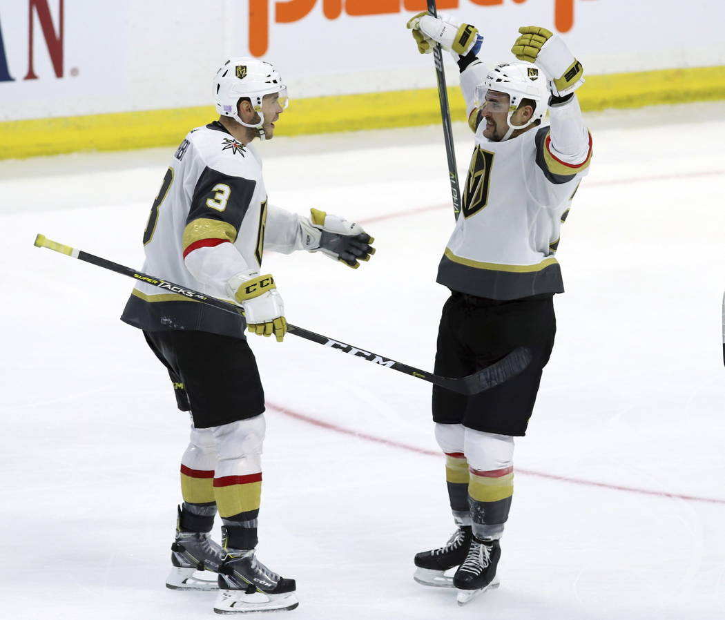 Vegas Golden Knights left wing William Carrier (28) celebrates with teammate defenseman Brayden McNabb (3) after scoring on the Ottawa Senators during the third period of an NHL hockey game, Wedne ...