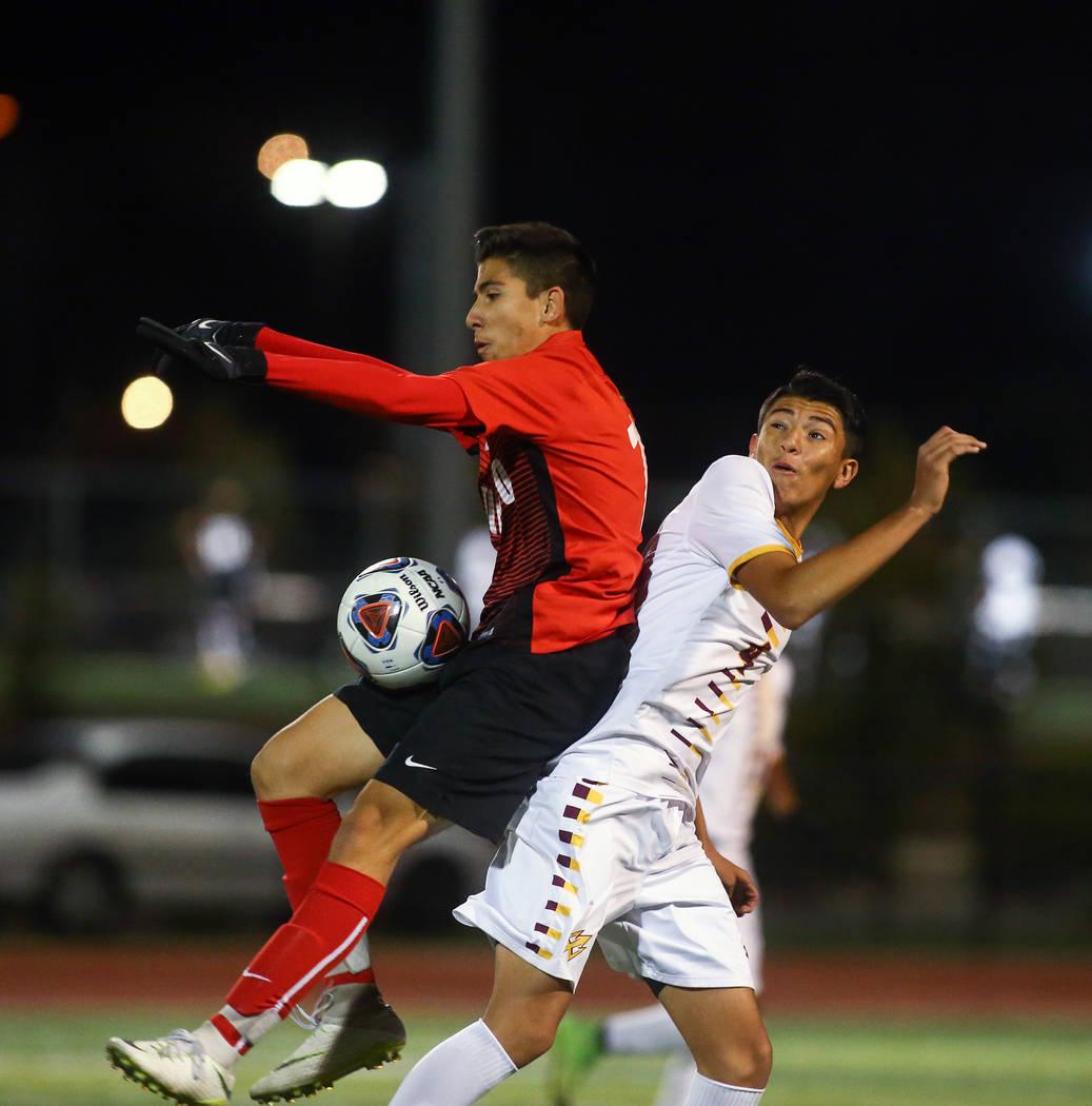 Coronado's Diaz Alfredo (13) traps the ball while under pressure from Eldorado's Alejandro Plaza (4) during the state quarterfinal game at Faith Lutheran High School in Las Vegas, Thursday,Nov. 8, ...