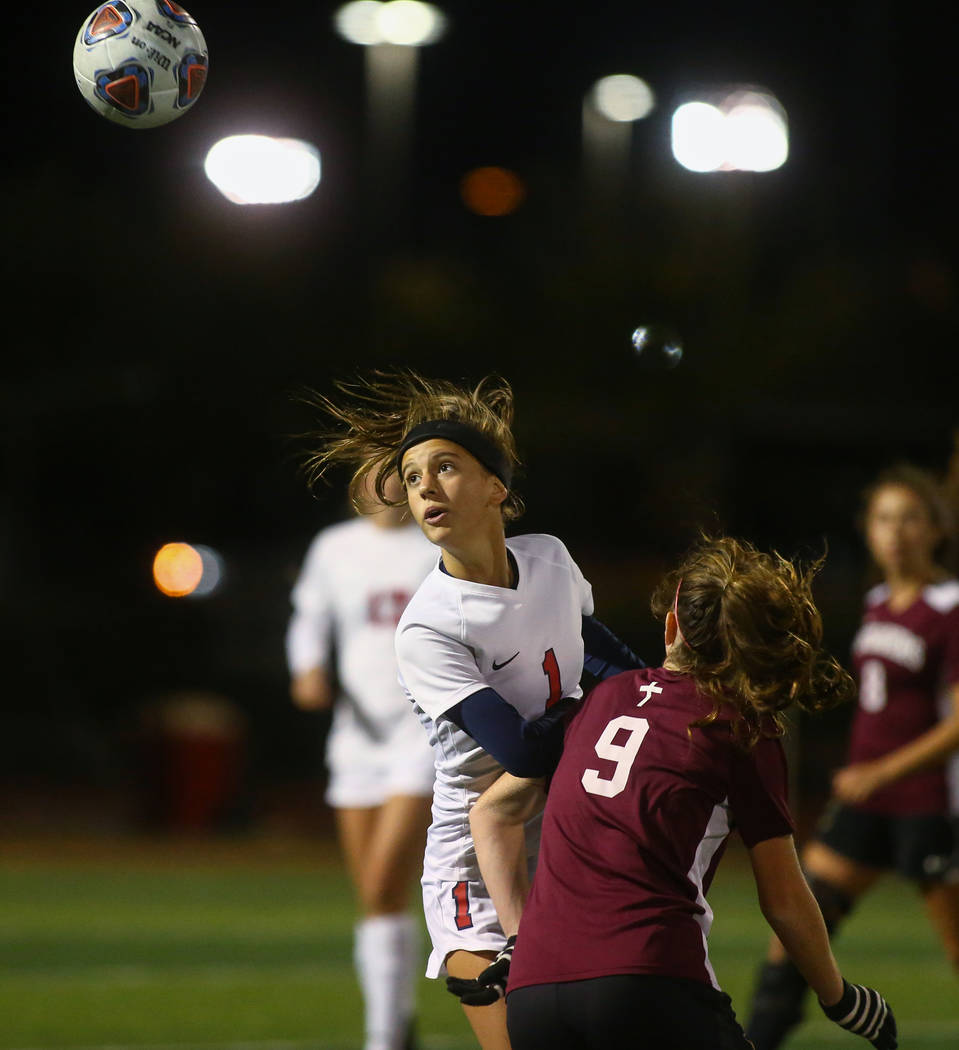 Coronado's Rachel Burt (1) heads the ball while being covered by Faith Lutheran's Dalbec (9) during the state quarterfinal game at Faith Lutheran High School in Las Vegas, Thursday, Nov. 8, 2018. ...
