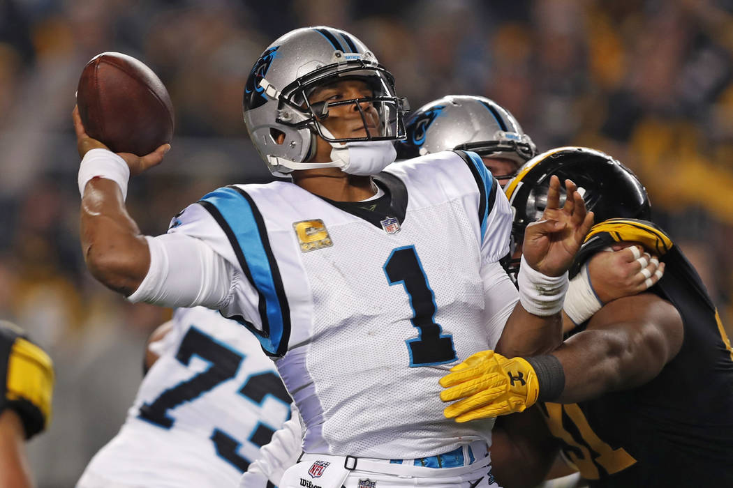 Carolina Panthers quarterback Cam Newton (1) throws a pass during the first half of the team's NFL football game against the Pittsburgh Steelers in Pittsburgh, Thursday, Nov. 8, 2018. (AP Photo/Ke ...