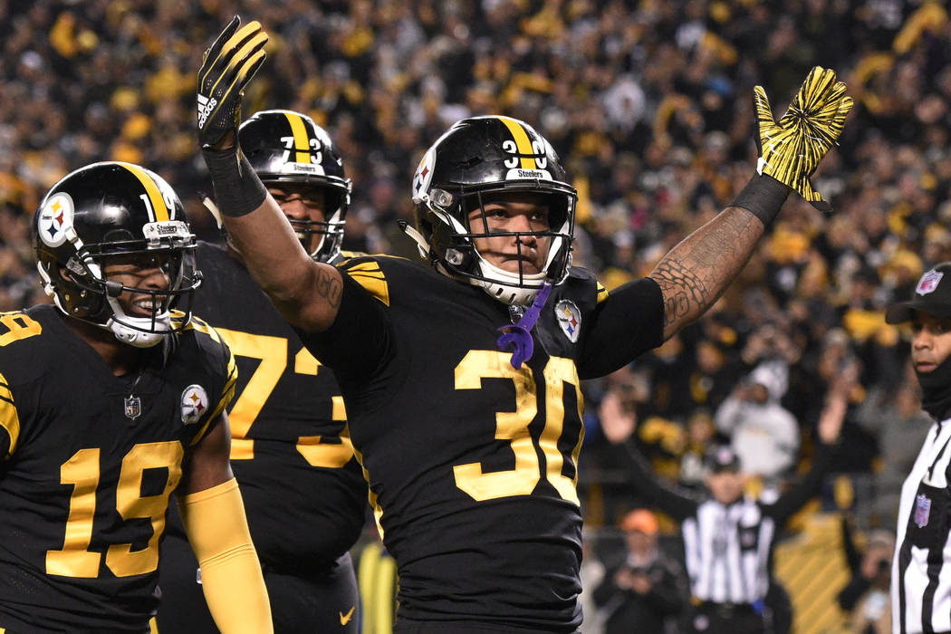 Pittsburgh Steelers running back James Conner (30) celebrates his touchdown against the Carolina Panthers during the first half of an NFL football game in Pittsburgh, Thursday, Nov. 8, 2018. (AP P ...