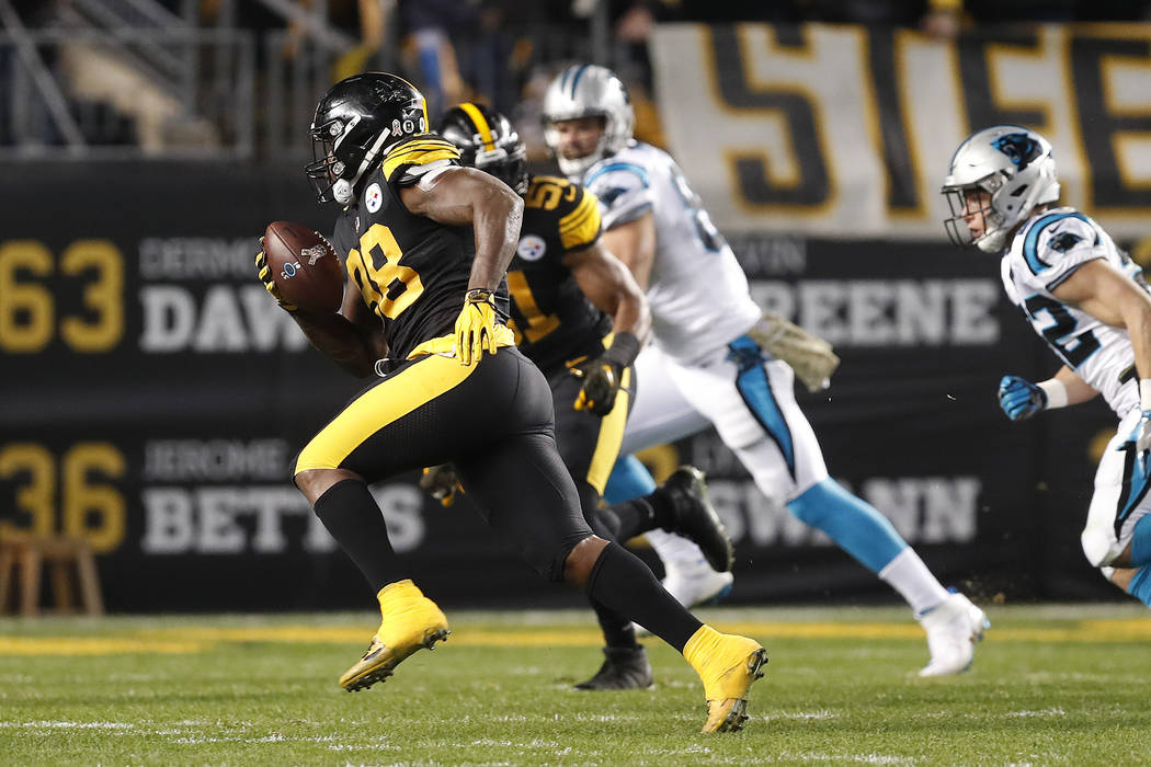 Pittsburgh Steelers inside linebacker Vince Williams (98) returns an interception for a touchdown during the first half of the team's NFL football game against the Carolina Panthers in Pittsburgh, ...
