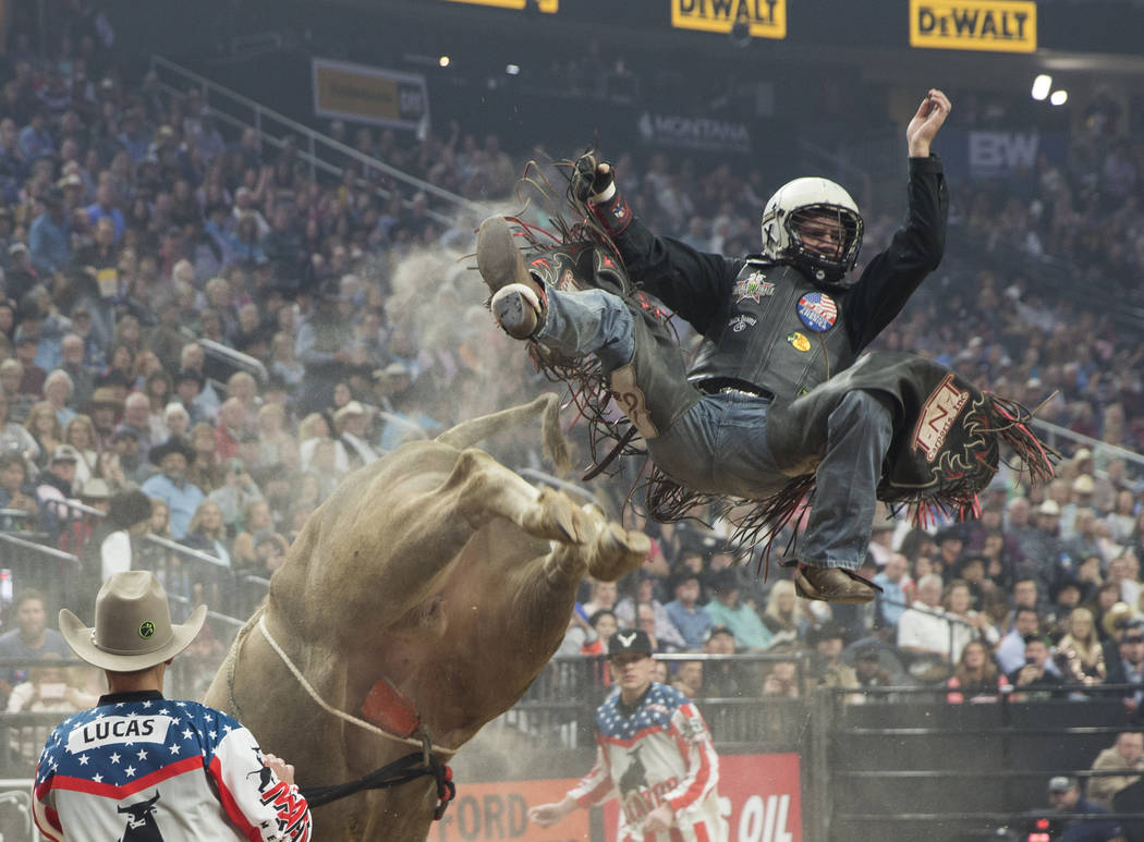 "Michael Lane gets thrown off of ""Heartbreak Kid"" during the Professional Bull Riders World Finals on Thursday, November 8, 2018, at T-Mobile Arena, in Las Vegas. Benjamin Hager Las Vegas ..."