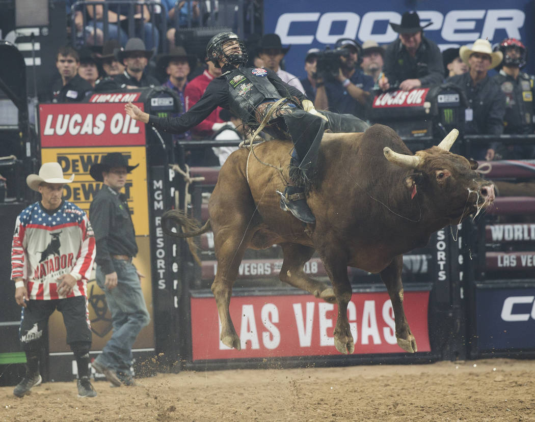 "Colton Jesse rides ""Frequent Flyer"" during the Professional Bull Riders World Finals on Thursday, November 8, 2018, at T-Mobile Arena, in Las Vegas. Benjamin Hager Las Vegas Review-Journal"