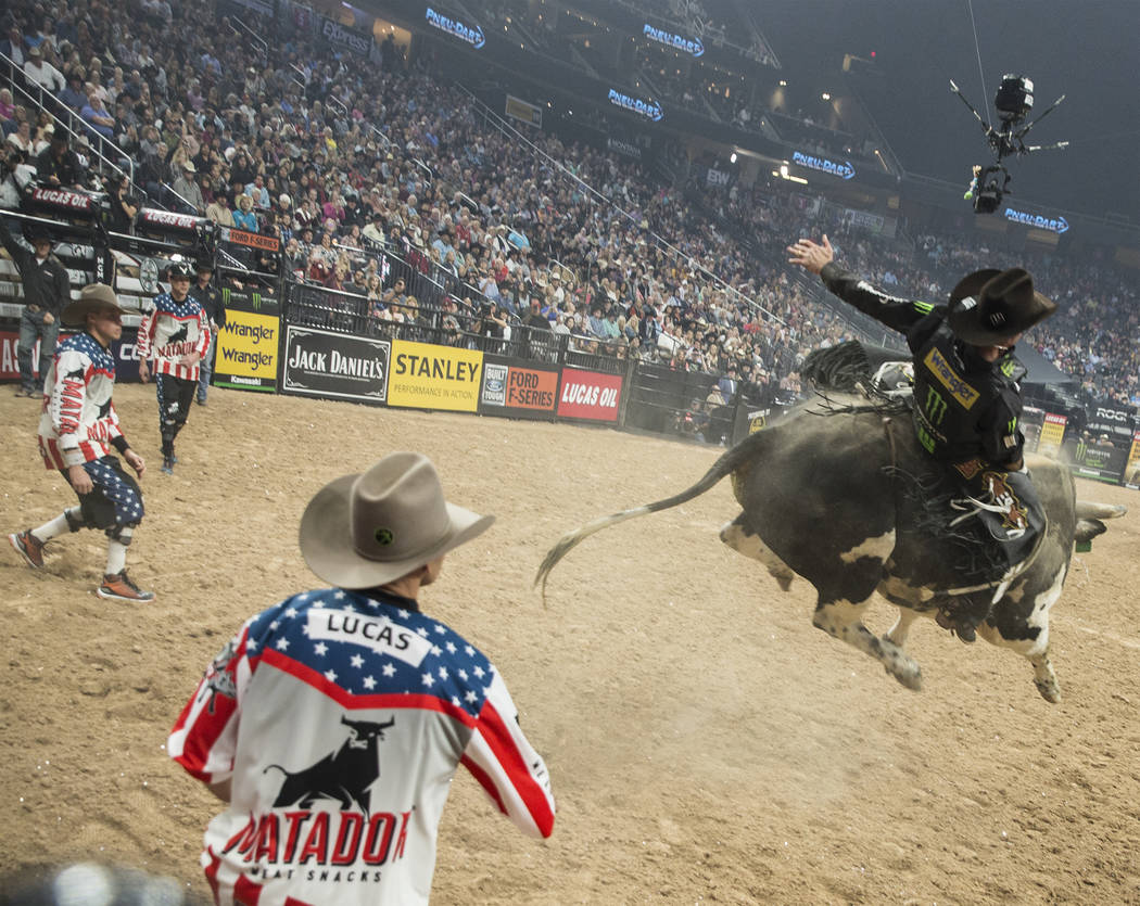 "Guilherme Marchi rides ""Roman"" during the Professional Bull Riders World Finals on Thursday, November 8, 2018, at T-Mobile Arena, in Las Vegas. Benjamin Hager Las Vegas Review-Journal"