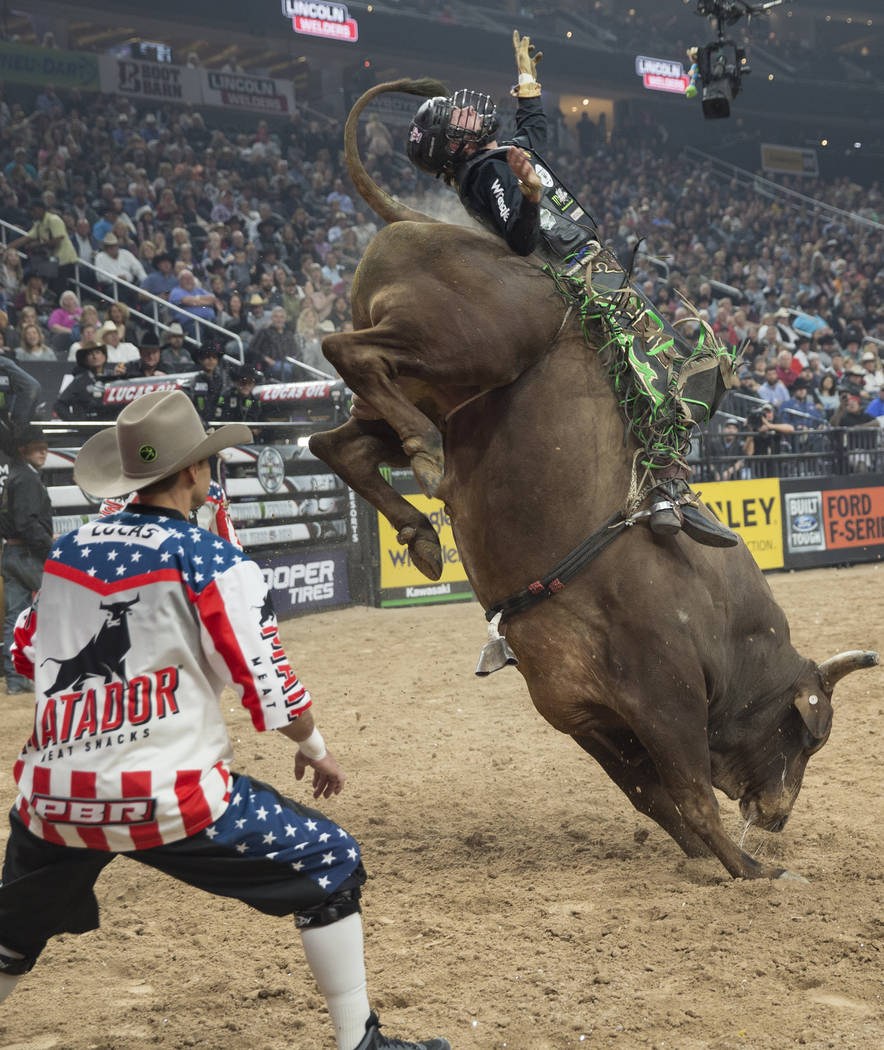 "Lonnie West rides ""Hostage"" during the Professional Bull Riders World Finals on Thursday, November 8, 2018, at T-Mobile Arena, in Las Vegas. Benjamin Hager Las Vegas Review-Journal"