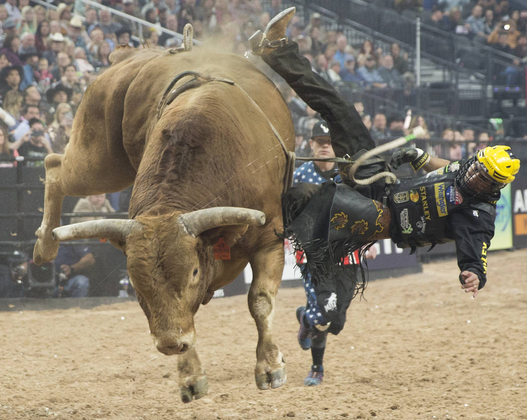 "Silvano Alves gets thrown off of ""Beaver Creek Beau"" during the Professional Bull Riders World Finals on Thursday, November 8, 2018, at T-Mobile Arena, in Las Vegas. Benjamin Hager Las V ..."