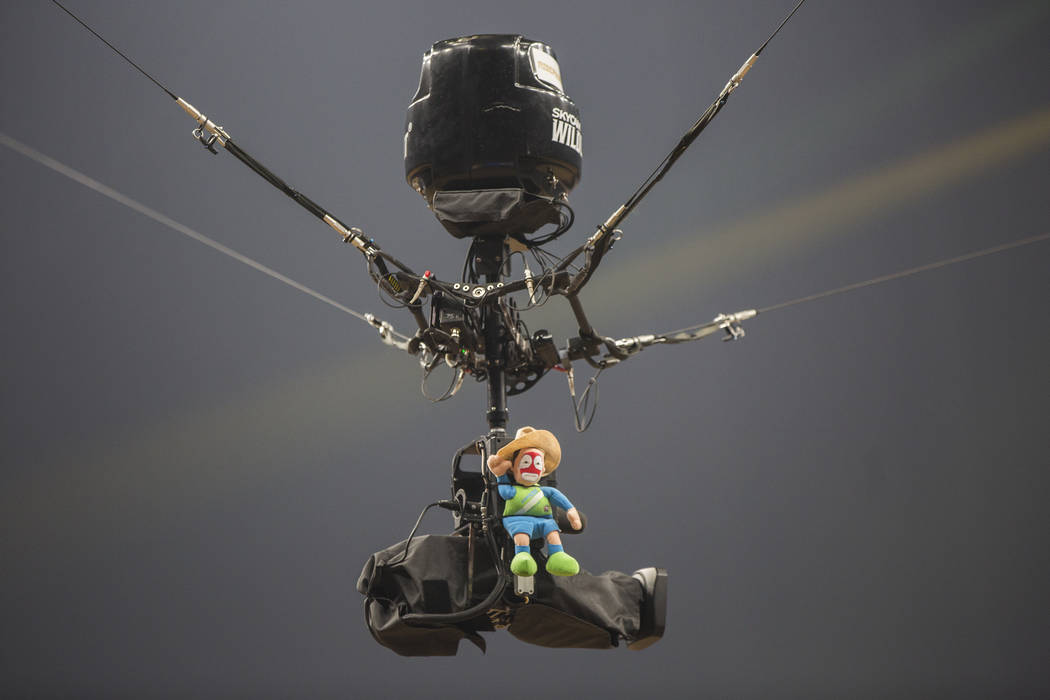 A toy rodeo clown rides the sky cam during the Professional Bull Riders World Finals on Thursday, November 8, 2018, at T-Mobile Arena, in Las Vegas. Benjamin Hager Las Vegas Review-Journal