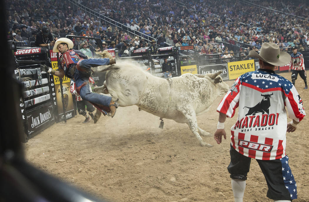 "Allisson De Souza gets bucked off of ""Lester Gillis"" during the Professional Bull Riders World Finals on Thursday, November 8, 2018, at T-Mobile Arena, in Las Vegas. Benjamin Hager Las V ..."