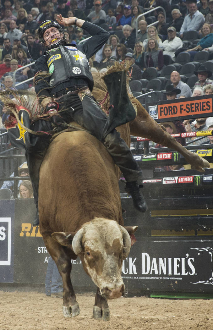 "Sean Willingham rides ""High Chaparral"" during the Professional Bull Riders World Finals on Thursday, November 8, 2018, at T-Mobile Arena, in Las Vegas. Benjamin Hager Las Vegas Review-Jo ..."