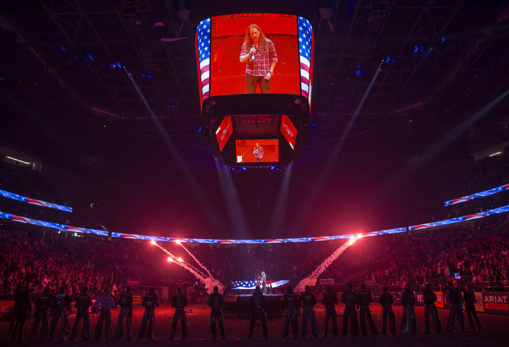 Christopher Shayne sings the national anthem before the start of the Professional Bull Riders World Finals on Thursday, November 8, 2018, at T-Mobile Arena, in Las Vegas. Benjamin Hager Las Vegas ...