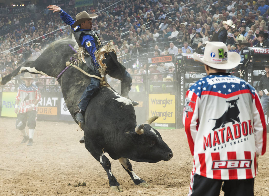 "Marco Antonio Eguchi rides ""Spotted Demon"" during the Professional Bull Riders World Finals on Thursday, November 8, 2018, at T-Mobile Arena, in Las Vegas. Benjamin Hager Las Vegas Revie ..."