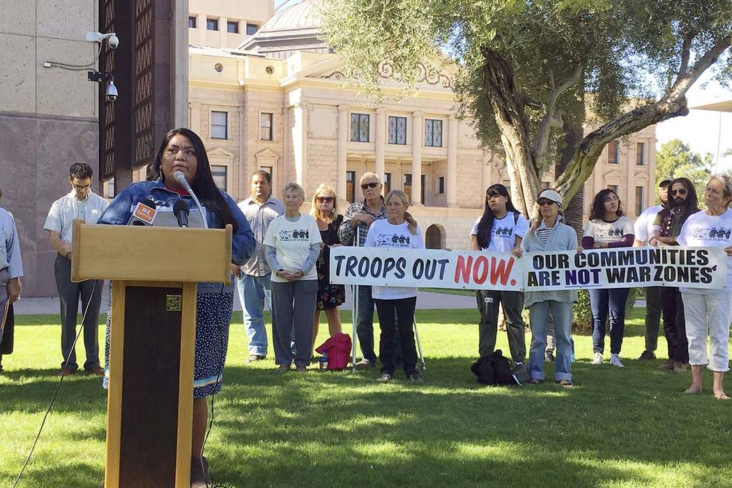 Amy Juan, a resident of the Tohono O'odham Nation in Arizona, speaks out against the military's presence at the U.S.-Mexico border in Phoenix Thursday, Nov. 8, 2018. Residents of border communitie ...