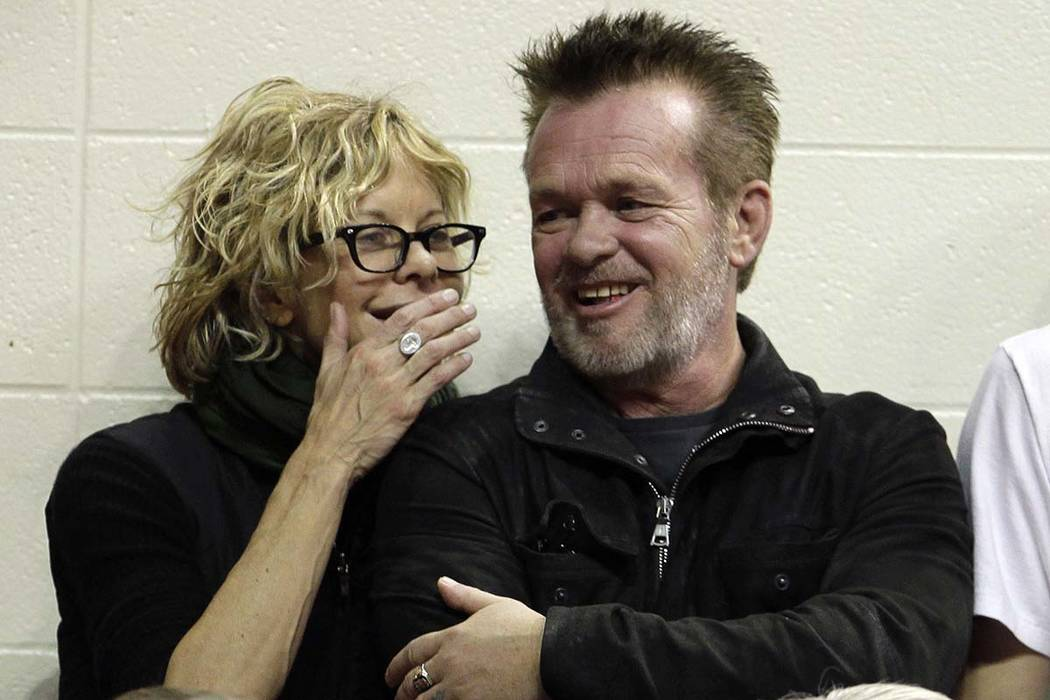 In this Dec. 31, 2011 file photo, actress Meg Ryan, left, talks with singer John Mellencamp during the second half of an NCAA college basketball game between Indiana and Ohio State in Bloomington, ...