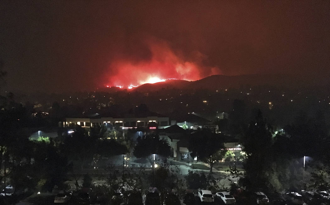 The Hill wildfire burns in the predawn hours of Friday, Nov. 9, 2018, seen from Agoura Hills in Southern California. The director of the California Governor's Office of Emergency Services says fir ...