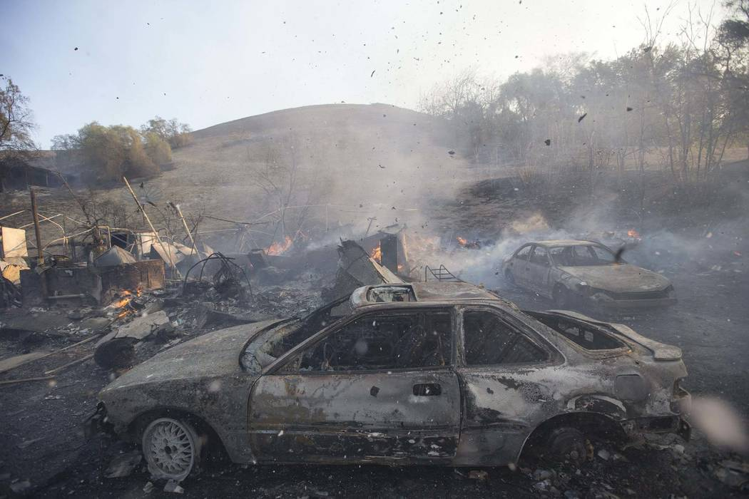 Burned cars are seen on a property ravaged by a wildfire in Thousand Oaks, Calif., on Friday, Nov. 9, 2018. (Richard Brian/Las Vegas Review-Journal) @vegasphotograph